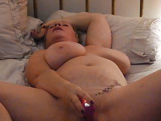 Milf Fucking her tattooed Pussy to Orgasm