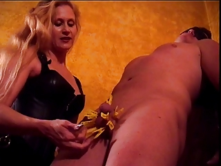 Mistress Amberle, teasing her slaves cock