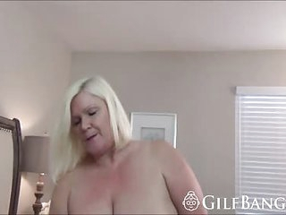 GILF takes a BBC between her thighs