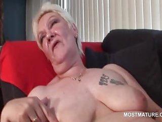 Slutty mature in stockings rubbing herself