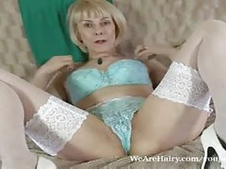 porno videos Hot mature Hazel flicks her moist hairy pussy
