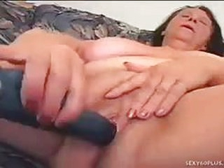Busty granny has some serious dick addiction and she fucks a much younger man